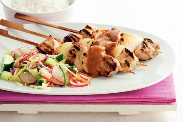 satay with sweet and sour raw vegetables
