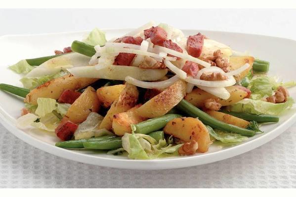lukewarm potato salad with bacon cubes