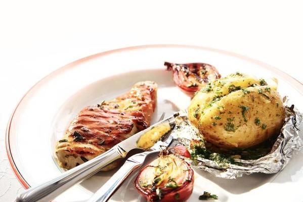 ham-wrapped pork steaks with potato and red onion