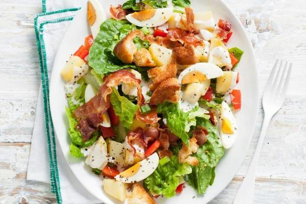 caesar salad of romain lettuce with potato and egg