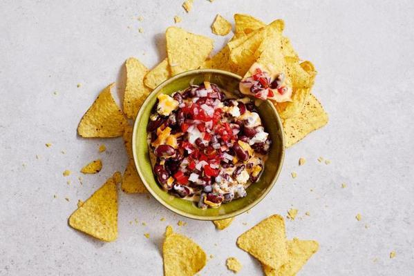 Mexican bean dip with cheddar and tomato salsa