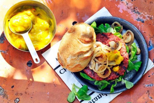 vegan burger with mushrooms, onion and piccalilli