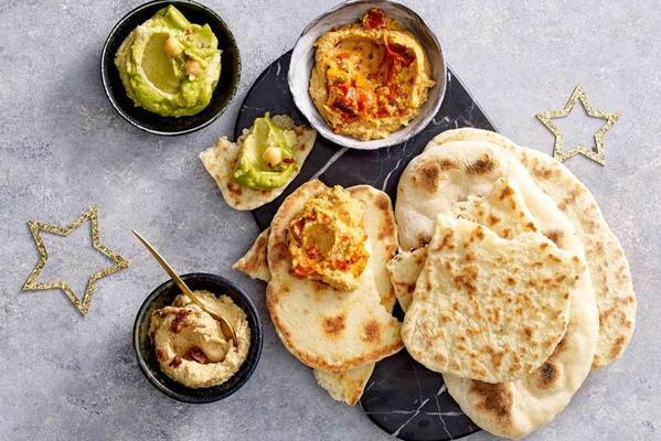 homemade naan bread with trio of hummus