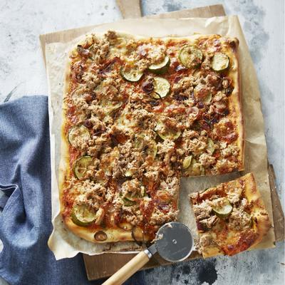 plate pizza with tuna, red onion and zucchini