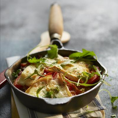 potato cake with bacon, cabbage and brie