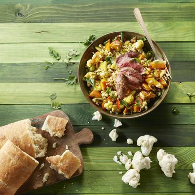 salad of roasted cauliflower and pumpkin with pearl barley and steak