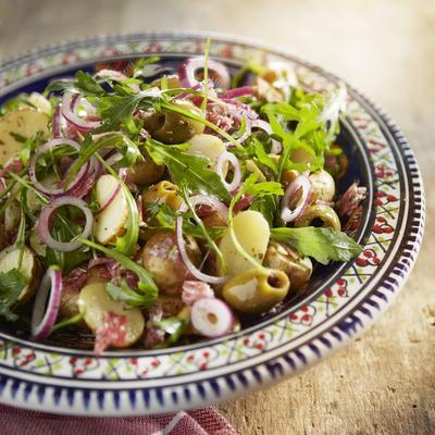lukewarm potato salad with salami and olives
