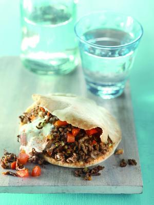 pita bread with spiced minced meat and chili cream