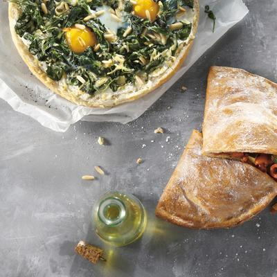 pide pizza with spinach, egg and herb cream cheese