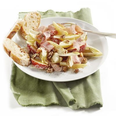 meal salad with chicory, fruit and ham