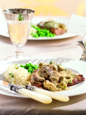veal slices with mushrooms in mustard sauce