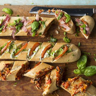 baguette with peppers, olives and parmesan cheese