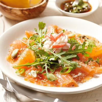 salmon carpaccio with arugula and crab