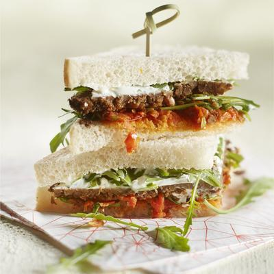 sandwich with tomato tapenade, rye bread and cheese spread