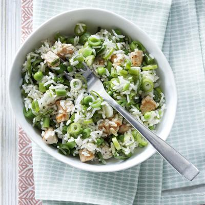 rice salad with green vegetables and turkey