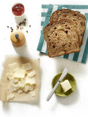 muesli bread with fig jam and parmesan cheese