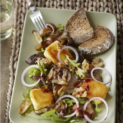 meal salad with mushrooms and fried camembert
