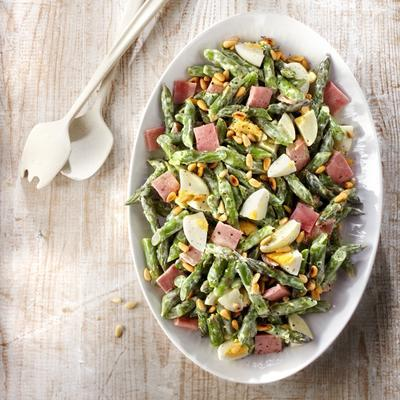 green asparagus salad with boiled egg and ham