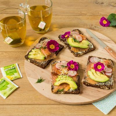 scandinavian rye bread rolls with salmon and avocado