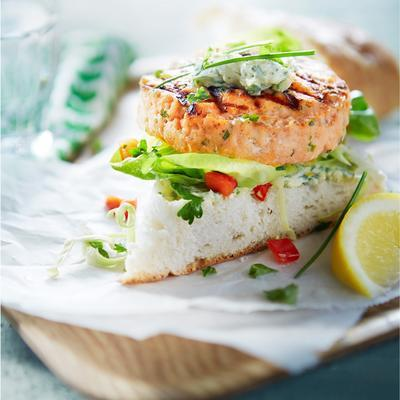 salmon burger with cabbage lettuce and herb butter