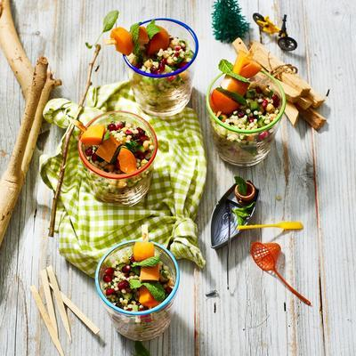 couscous salad with chicken-fruit skewer