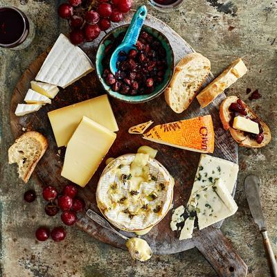 generous cheese plate with onion marmalade