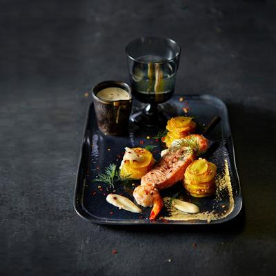 fish skewer with seasoned pommes anna and spicy turmeric yoghurt