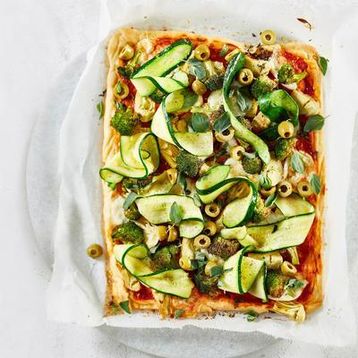 plate pizza with artichoke, broccoli, zucchini and green olives