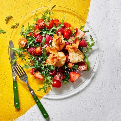 salad with red fruit and crispy goat cheese