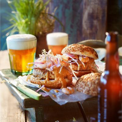 surf and turf burger with bean sprouts and chili sauce