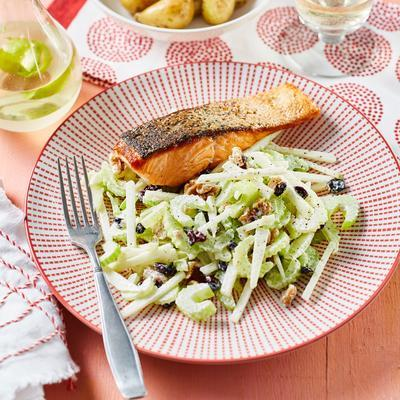 waldorf salad with salmon fillet and fried potatoes