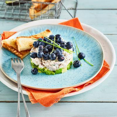 tartlet of poached chicken with avocado and blueberries