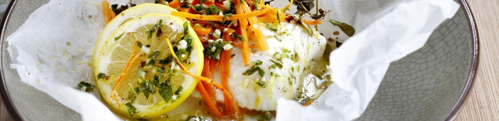 fish packages with herb sauce and lemon rice