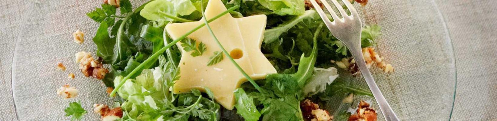 green salad with cheese stars and honey-nut crunch