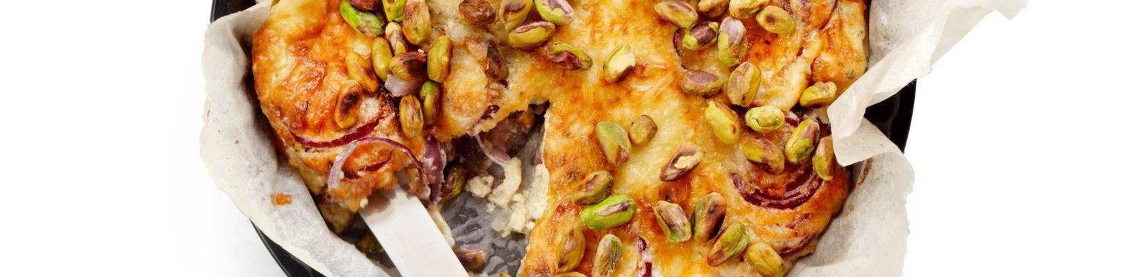 red onions gratin with pistachio nuts