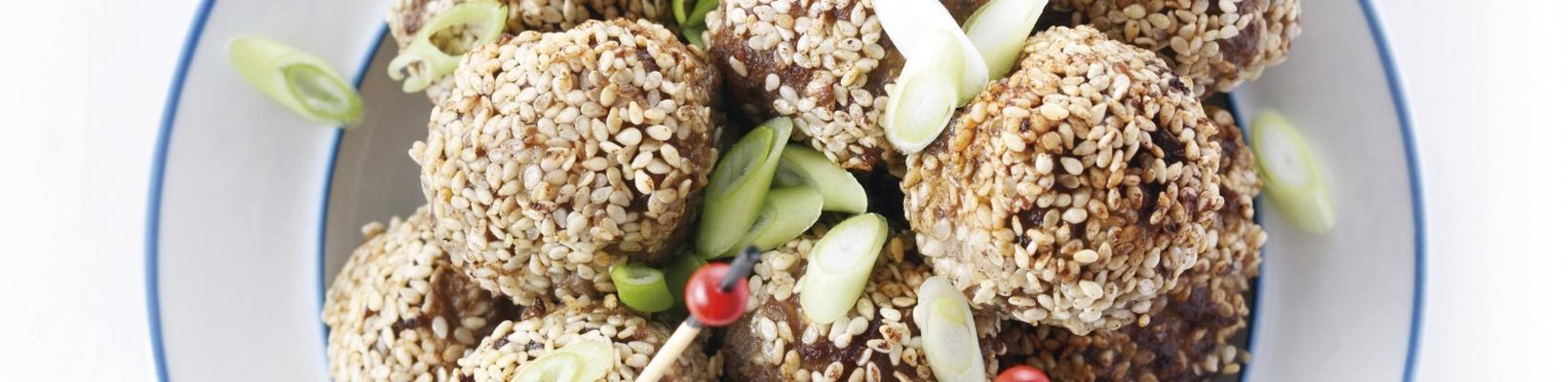 snack balls in a crust of sesame
