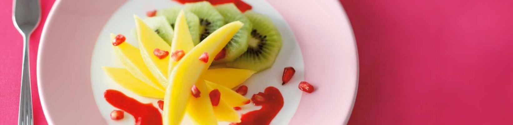 kiwi-mango salad with forest fruit coulis