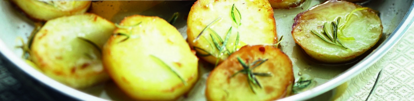 thick potato slices with butter and lemon