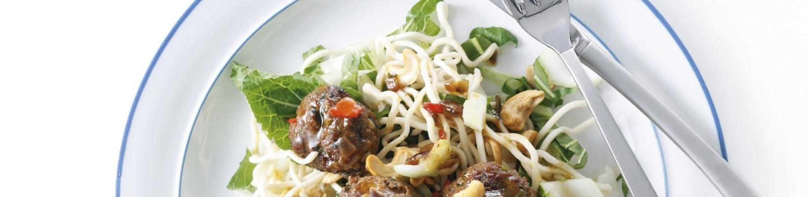 noodle salad with meatballs and cashew nuts
