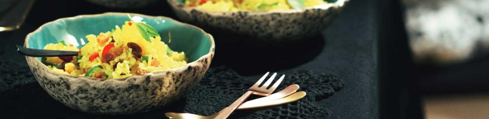 bowls of curry rice salad