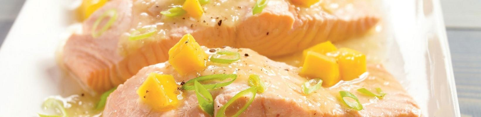 poached salmon with spring onions and mango