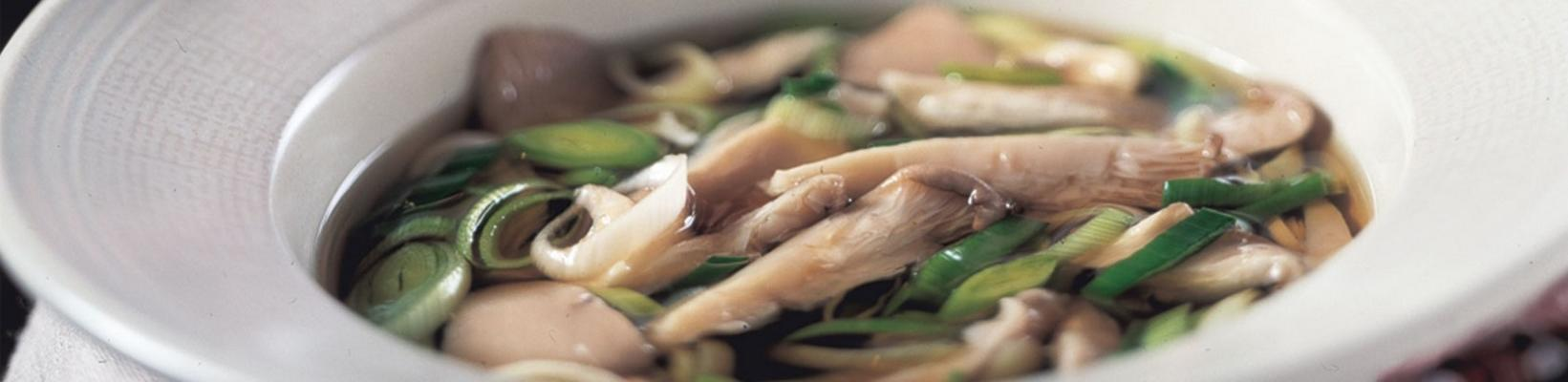chicken broth with mushrooms and leek rings