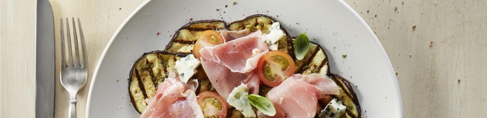 aubergine carpaccio with raw ham and roquefort