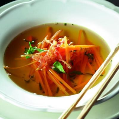 broth with strips of carrots and crispy breakfast bacon