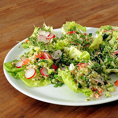 fresh quinoa salad with broccoli, tomato, cucumber and spring onion