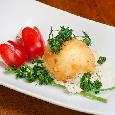 tomatoes filled with herb cheese and chives