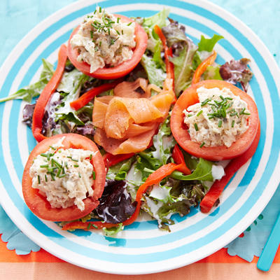 meal salad with stuffed tomatoes with salmon