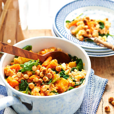 summer stew with spinach and fried hazelnuts