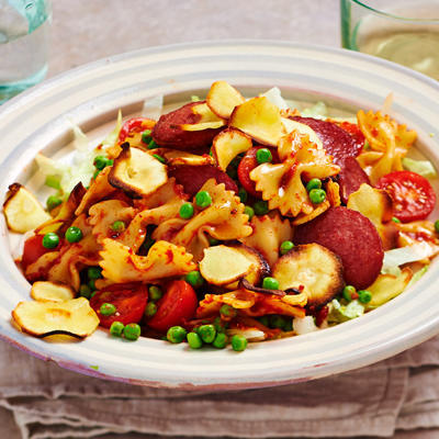 pasta salad with tomato dressing and grilled parsnip