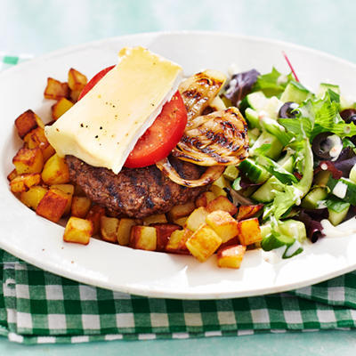 cheeseburgers with baked potatoes and salad